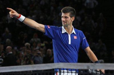Novak Djokovic pulls away to advance in Miami Open