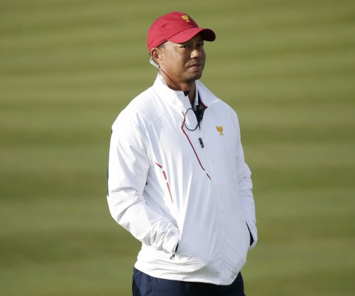 Tiger Woods pleads guilty to reckless driving, enters diversion program