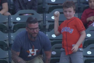 Boy throws back Alex Bregman home run ball, shocks dad