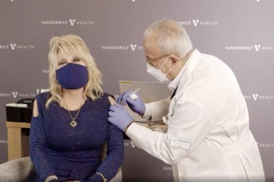 Dolly Parton receives COVID-19 vaccine she helped fund