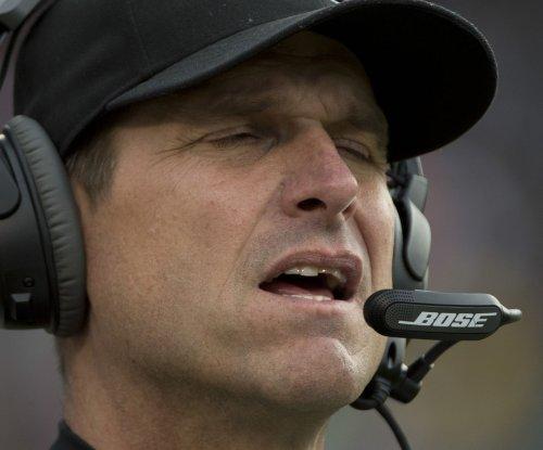 Michigan coach Jim Harbaugh blames Los Angeles Rams rumors on 'enemy' coaches