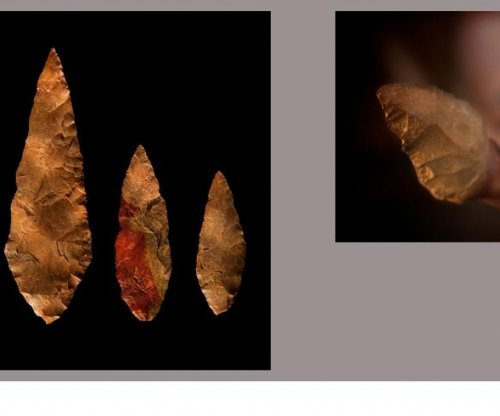 How did early humans survive aridity and prolonged drought in Africa?