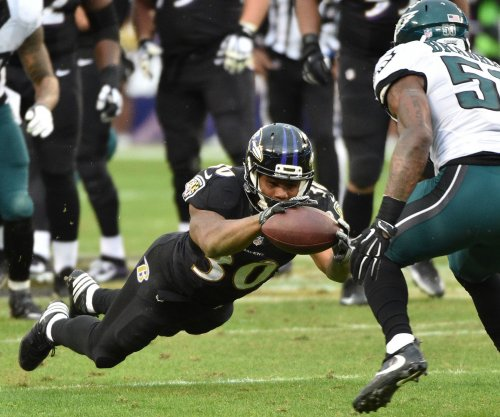 Ravens RB Dixon eager to go after sitting out 2017