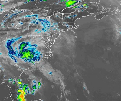 Bertha weakens to a depression as it spreads heavy rain over Carolinas