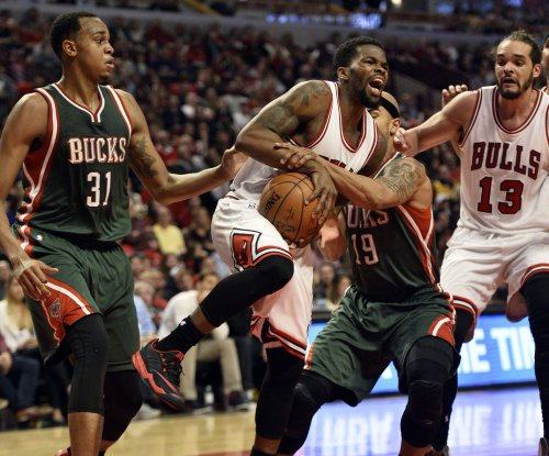 Rose, Chicago Bulls bounce Milwaukee Bucks