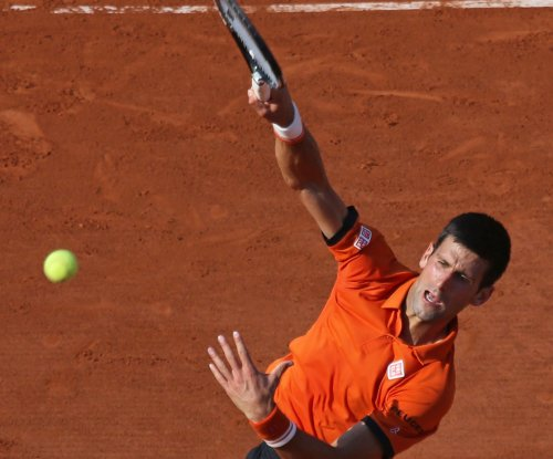 Djokovic-Murray suspended; Wawrinka reaches first French Open final