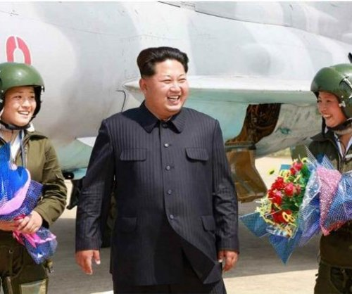 Kim Jong Un fawns over North Korea's first female fighter pilots