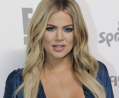 Khloe Kardashian leaves Lamar Odom's bedside to attend James Harden's basketball game