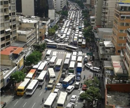 Bus drivers block Caracas in protest of Nicolas Maduro, a former bus driver
