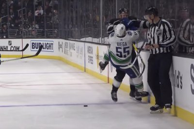 Kings' Ilya Kovalchuk lays out two Canucks players in five seconds