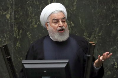 Iran threatens to boost enriched uranium stockpile