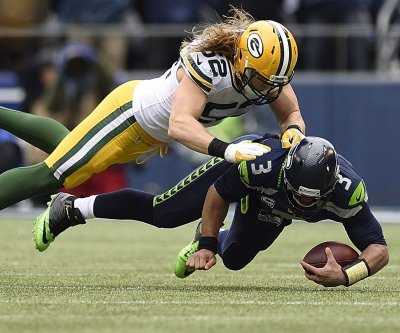 Green Bay Packers' Clay Matthews makes a pit stop