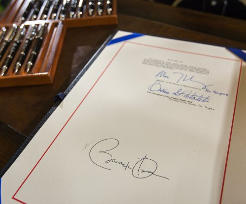 Obama makes rare use of autopen to sign highway funding bill