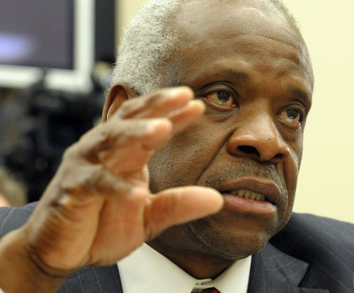 Justice Thomas asks a question from the bench for the first time in 10 years