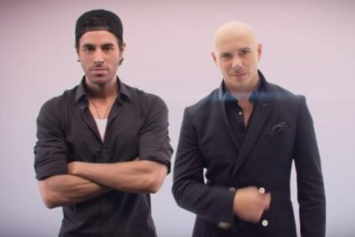 Pitbull, Enrique Iglesias pose with models in 'Messin' Around' video