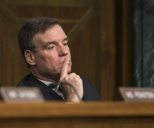 Warner wants to know if Comey pressured to halt Russia probe