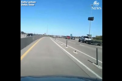 Watch:-Flying-trash-can-collides-with-car-on-freeway