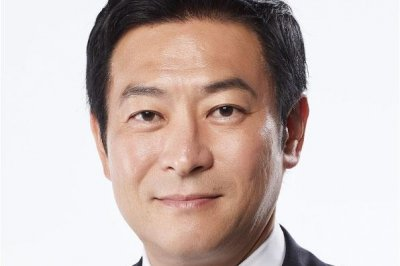 Japan lawmaker splits from party after arrest for bribery