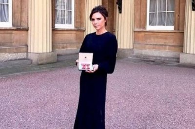 Victoria Beckham honored with OBE from Prince William