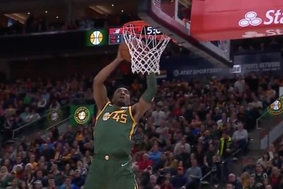 Jazz star Donovan Mitchell dunks half-court alley oop