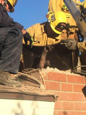 Firefighters free alleged intruder from chimney