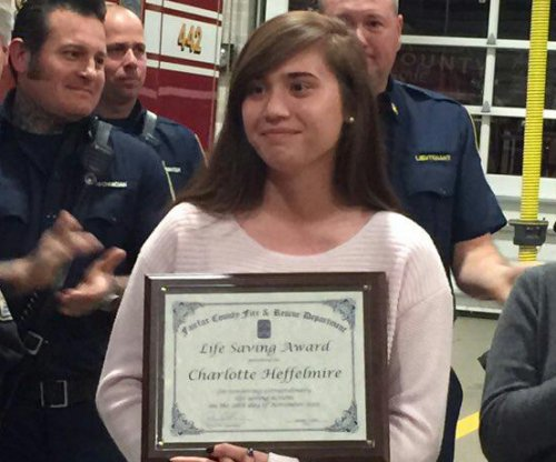 Woman, 19, honored for lifting pickup truck off pinned father during fire