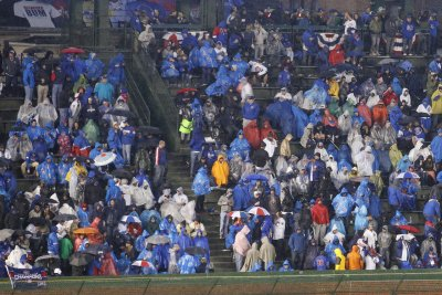 Chicago Cubs fans relish their rain-delayed victory celebration