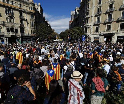 Spanish police raids seen as attempt to thwart Catalonian referendum