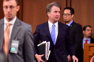 Kavanaugh accuser offers to testify next week, but not Monday