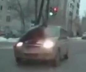 Police officer clings to car hood for over a mile