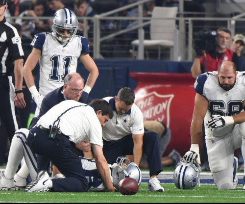 Tony Romo reinjures shoulder