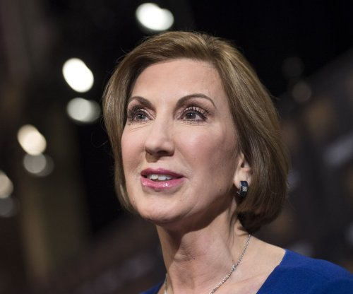 Fiorina pressures RNC to allow her on debate stage Saturday
