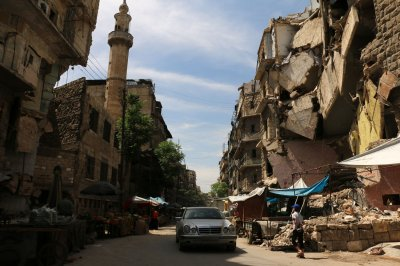 Syrian rebels to leave besieged Damascus suburb, give weapons to Assad regime