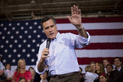 Romney says 'firing' remark misinterpreted