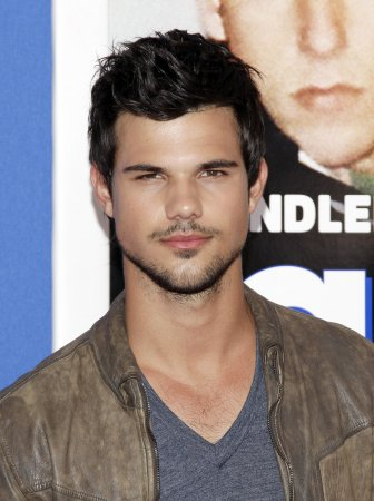 Marie Avgeropoulos and Taylor Lautner hold hands, each other at Jay Z concert