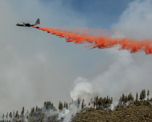 Firefighters hold the line on two large wildfires in northern California