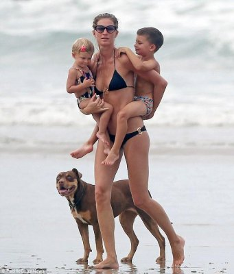 Gisele Bundchen poses with her dog during beach vacation