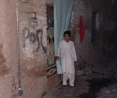 Survivors of slain Pakistani police officers await compensation