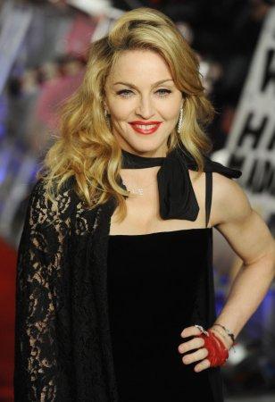 Elton's hubby blasts Madonna Globe grab