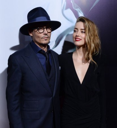 Amber Heard takes Johnny Depp to '3 Days to Kill' premiere