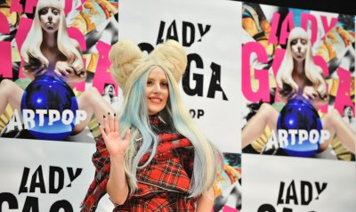 Lady Gaga tones down look with classic pink coat, simple blowout
