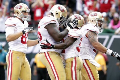 San Francisco 49ers OT Davis, 25, walking away from football