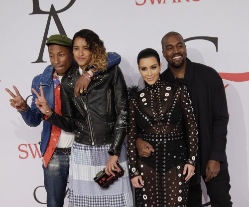 Kim Kardashian's dress caught fire at the CDFA Awards and Pharrell put it out
