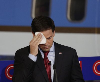 Trump trolls Rubio with water, mocks Rubio's perspiration