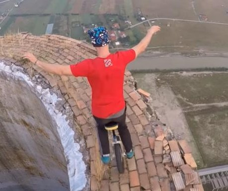 Daredevil unicyclist performs tricks atop 840-foot chimney