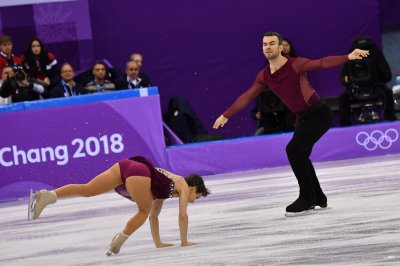 Eric Radford becomes first openly gay athlete to win gold at Winter Olympics
