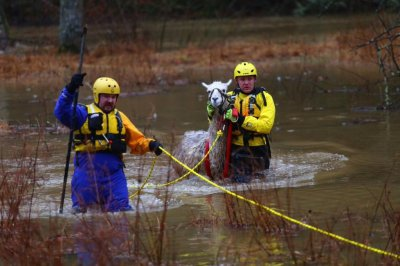 Severe weather slams U.S. coasts with rain, floods, large waves
