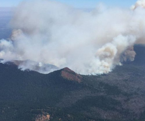Oregon town prepares to evacuate as wildfire, eclipse loom