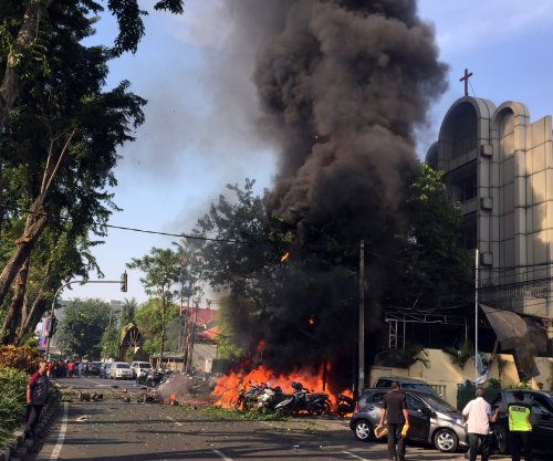Suicide bombings kill 7 attending church services in Indonesia