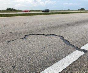 Lightning strikes car on Florida highway, leaves gouge in road